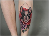 Coloured portrait of a doggy tattoo on leg