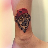 Cubism dog in a red beret ankle tattoo