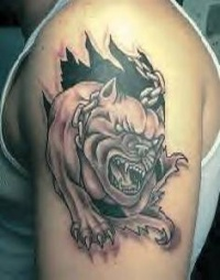 Angry bull terrier on chain skin rip tattoo